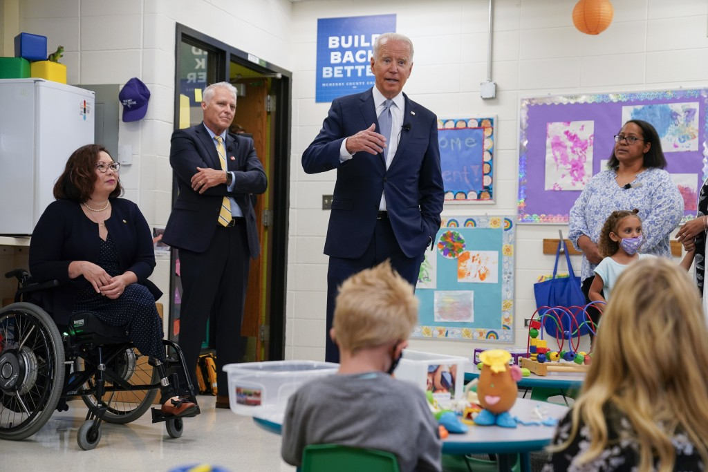 President Joe Biden speaks as he tours a children's learning center at McHenry County College, Wednesday, July 7, 2021, in Crystal Lake, Ill. Sen. Tam...