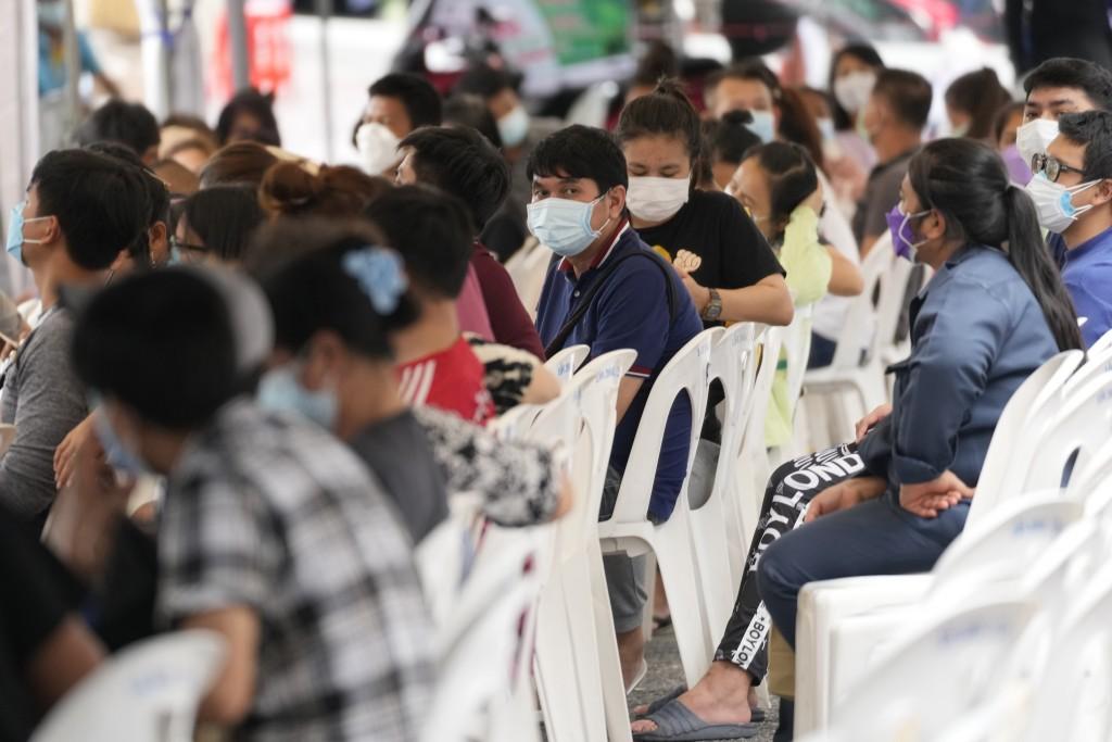 Local residents wait to be tested for coronavirus in Bangkok, Thailand, Thursday, July 8, 2021. (AP Photo/Sakchai Lalit)