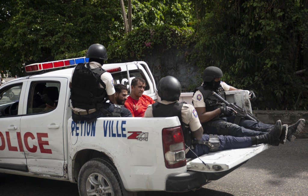 The police take two detainees to the police station of Petion Ville in Port-au-Prince, Haiti, Thursday, July 8, 2021. According to Police Chief Leon C...