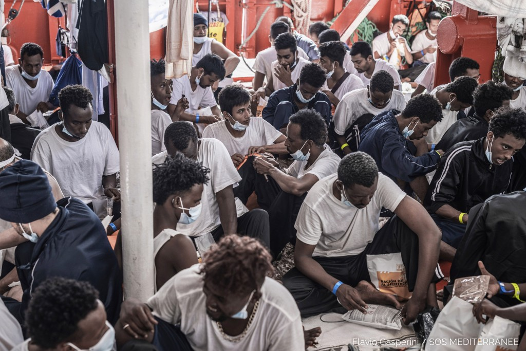Food is being distributed to migrants aboard the Ocean Viking rescue, in the Mediterranean Sea on Thursday, July 8, 2021. A charity rescue ship with 5...