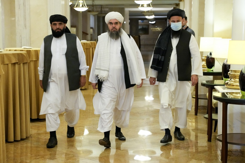 From left, Suhil Shaheen, Mawlawi Shahabuddin Dilawar and Mohammad Naim, members of a political delegation from the Afghan Taliban's movement, arrive ...
