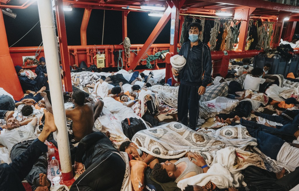 Migrants sleep on the deck of the Ocean Viking rescue in the Mediterranean Sea on Tuesday, July 5, 2021. A charity rescue ship with 572 migrants aboar...