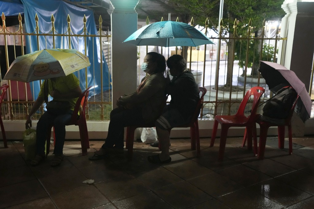 Locals wait in line overnight for free coronavirus testing at the Wat Phra Si Mahathat temple in Bangkok, Thailand, Friday, July 9, 2021. After initia...