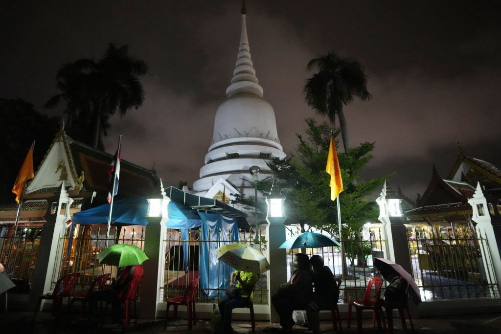 Locals wait in line overnight for free coronavirus testing at Wat Phra Si Mahathat temple in Bangkok, Thailand, Friday, July 9, 2021. Faced with rapid...