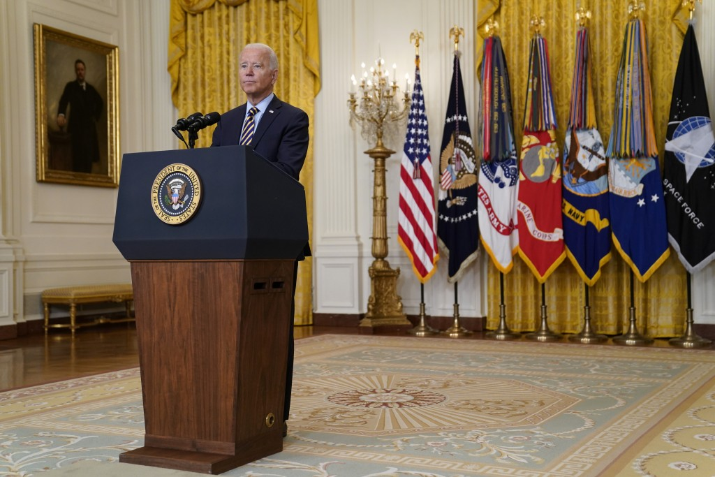 President Joe Biden listens to a question as he speaks about the American troop withdrawal from Afghanistan, in the East Room of the White House, Thur...