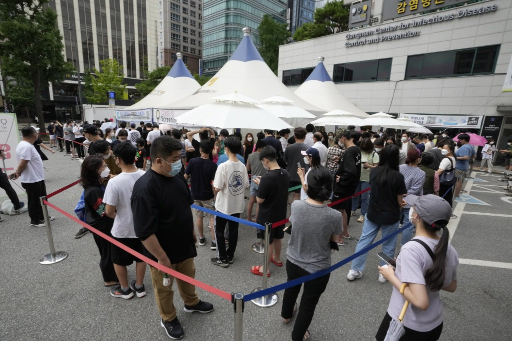 In this July 9, 2021, file photo, people queue in line to wait for the coronavirus testing at a Public Health Center in Seoul, South Korea. South Kore...