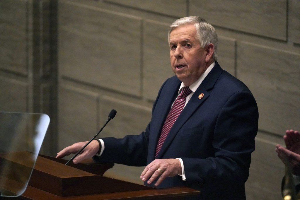 FILE - In this Jan. 27, 2021 file photo, Missouri Gov. Mike Parson delivers the State of the State address in Jefferson City, Mo. Federal officials ar...
