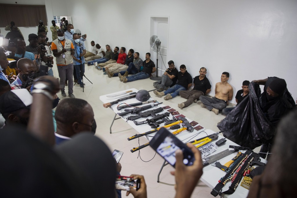 Suspects in the assassination of Haiti's President Jovenel Moise are shown to the media, along with the weapons and equipment they allegedly used in t...
