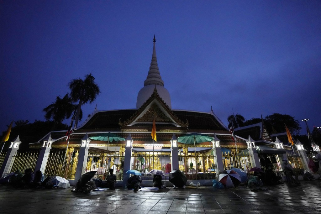 Locals wait in line overnight for free the coronavirus testing at Wat Phra Si Mahathat temple in Bangkok, Thailand, Friday, July 9, 2021. Faced with r...