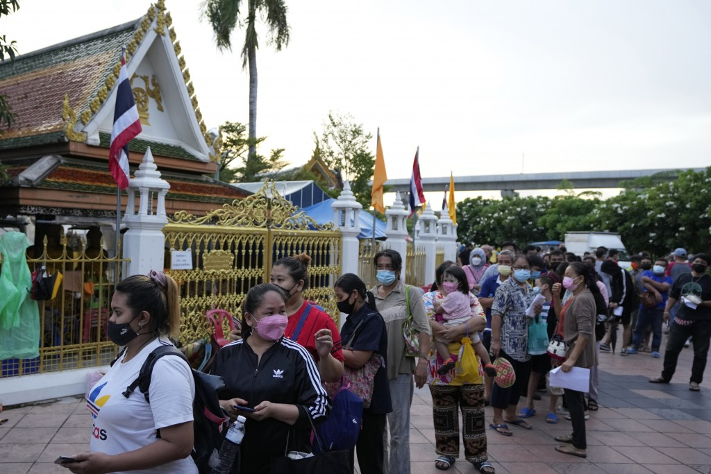 Locals wait in line overnight for free coronavirus testing at the Wat Phra Si Mahathat temple in Bangkok, Thailand, Friday, July 9, 2021. Faced with r...