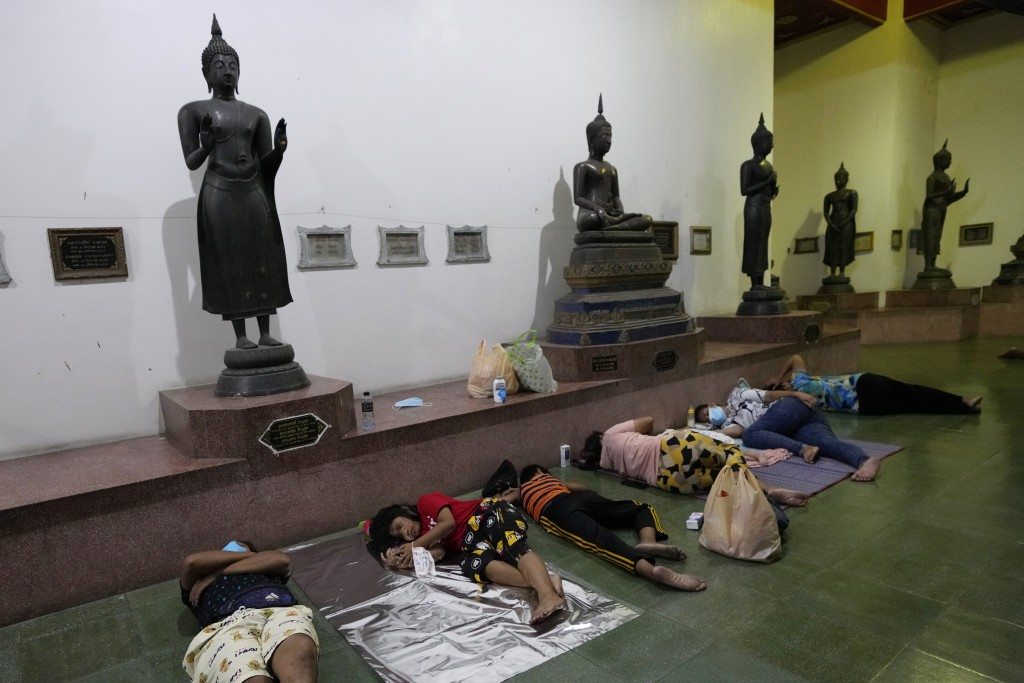 Locals sleep in line overnight for free coronavirus testing at Wat Phra Si Mahathat temple in Bangkok, Thailand, Friday, July 9, 2021. Faced with rapi...