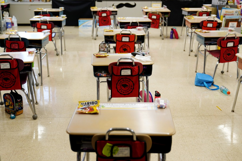 FILE - In this Thursday, March 11, 2021 file photo, desks are arranged in a classroom at an elementary school in Nesquehoning, Pa. In the fall of 2021...