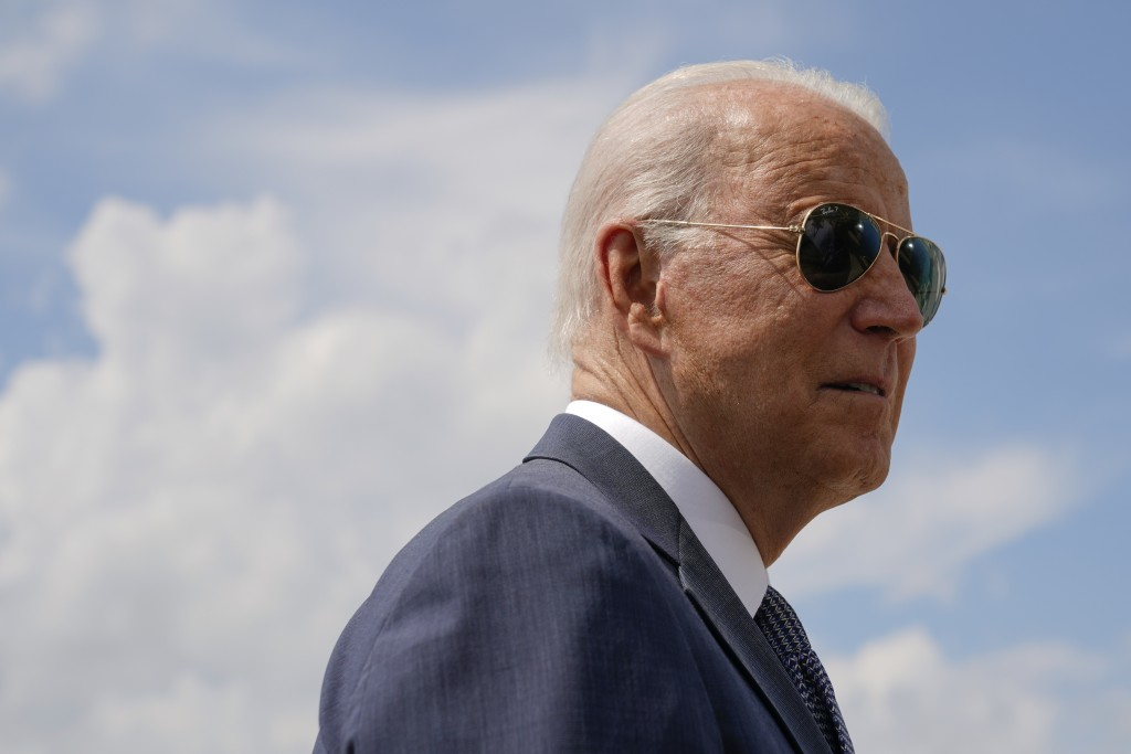 President Joe Biden speaks with members of the press before boarding Air Force One, Friday, July 9, 2021, at Andrews Air Force Base, Md. Biden is spen...