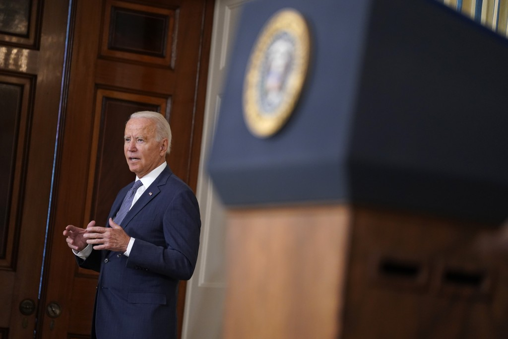 President Joe Biden speaks after signing an executive order aimed at promoting competition in the economy, in the State Dining Room of the White House...