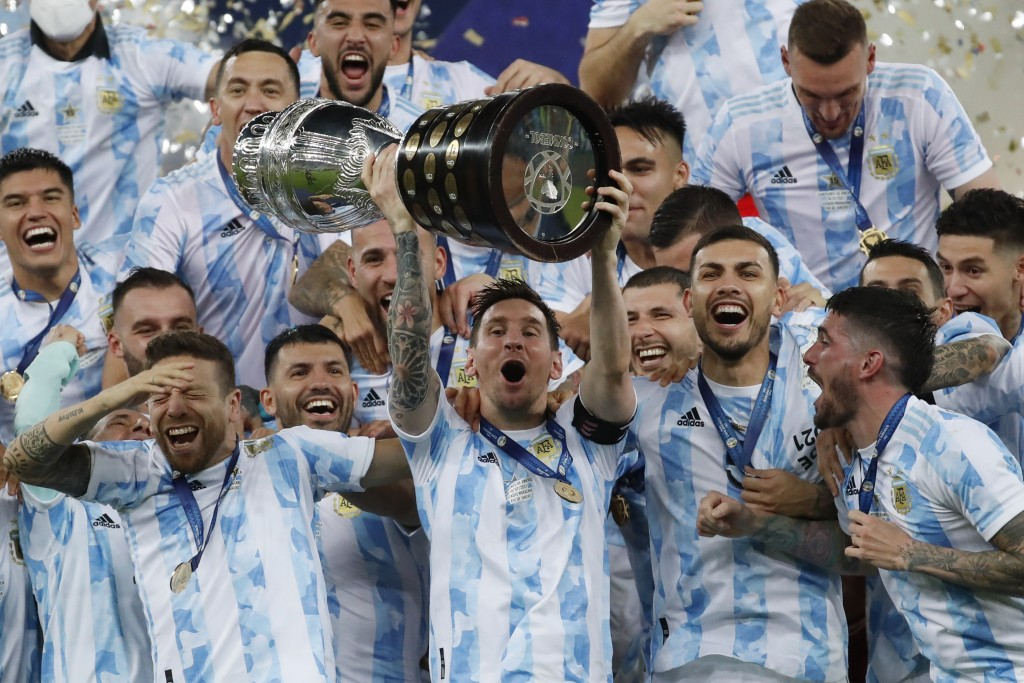 Argentina's Lionel Messi hoists the trophy after beating Brazil 1-0 in the Copa America final soccer match at Maracana stadium in Rio de Janeiro, Braz...