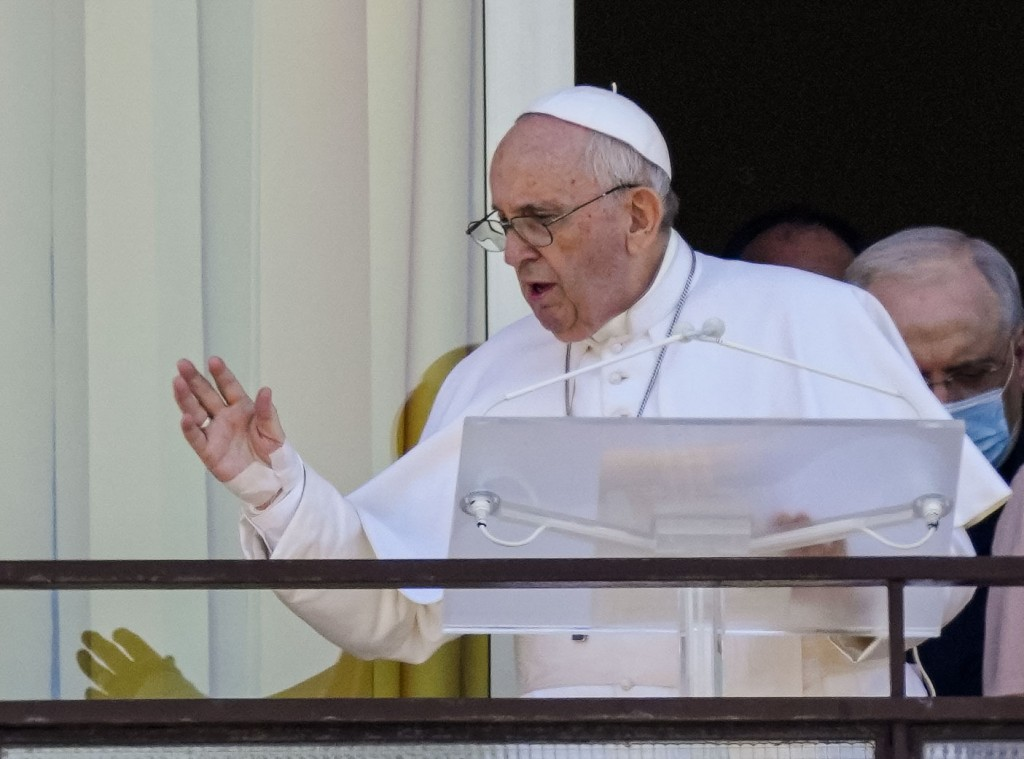 Pope Francis appears on a balcony of the Agostino Gemelli Polyclinic in Rome, Sunday, July 11, 2021, where he is recovering from intestinal surgery, f...