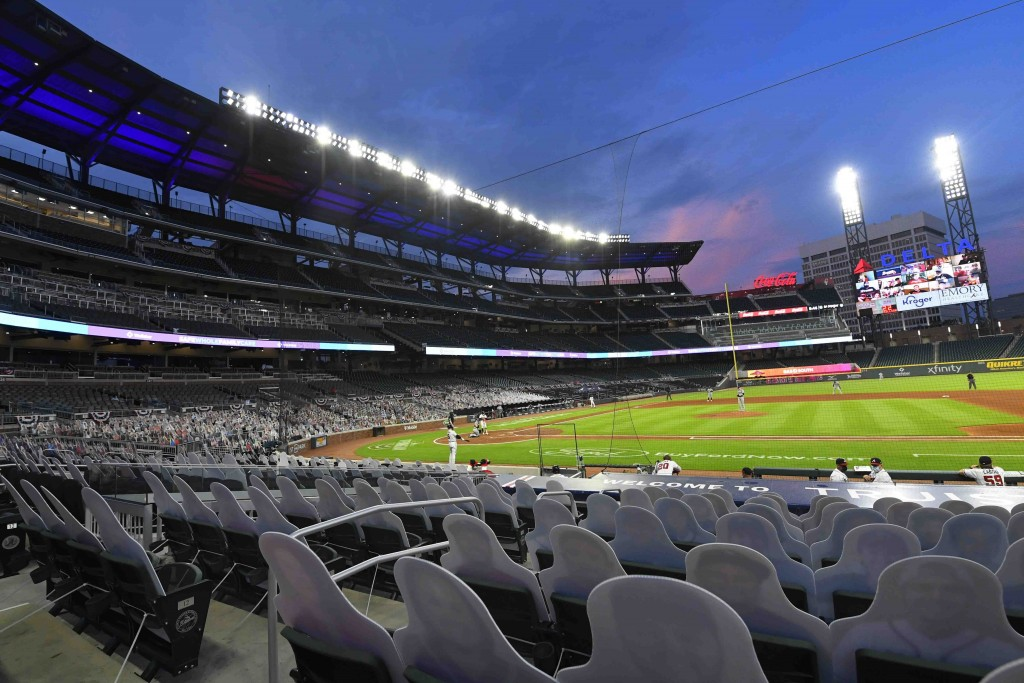 FILE - This photo from Thursday July 30, 2020, shows cardboard cutouts of fans in seats during a baseball game between the Atlanta Braves and Tampa Ba...