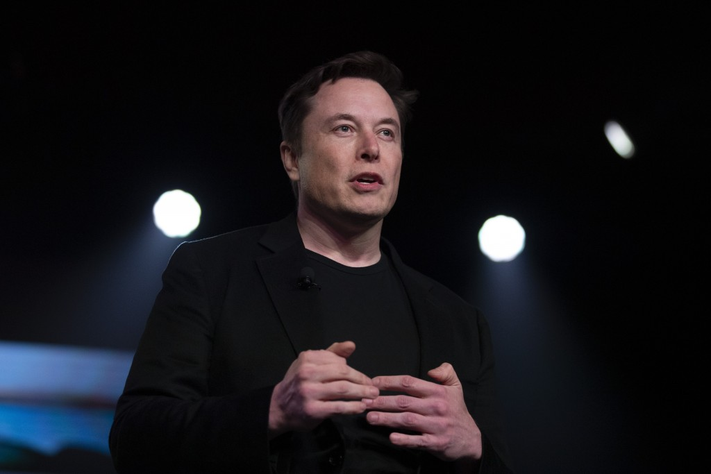 FILE - In this March 14, 2019, file photo, Tesla CEO Elon Musk speaks before unveiling the Model Y at the company's design studio in Hawthorne, Calif....