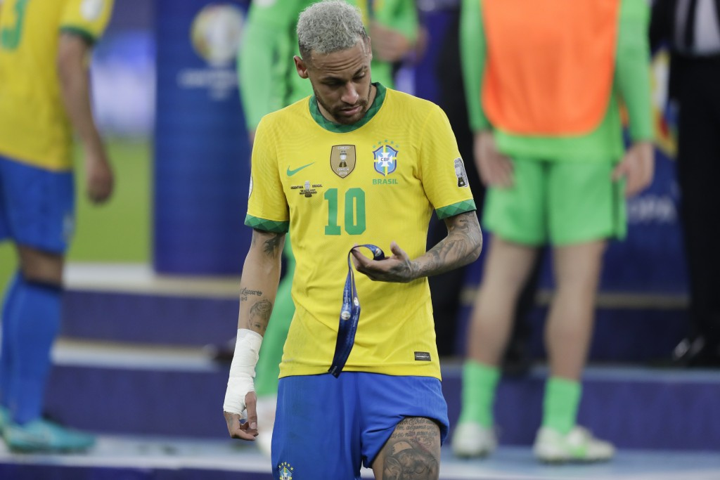 Brazil's Neymar holds the second place medal during the award ceremony for the Copa America at Maracana stadium in Rio de Janeiro, Brazil, Saturday, J...