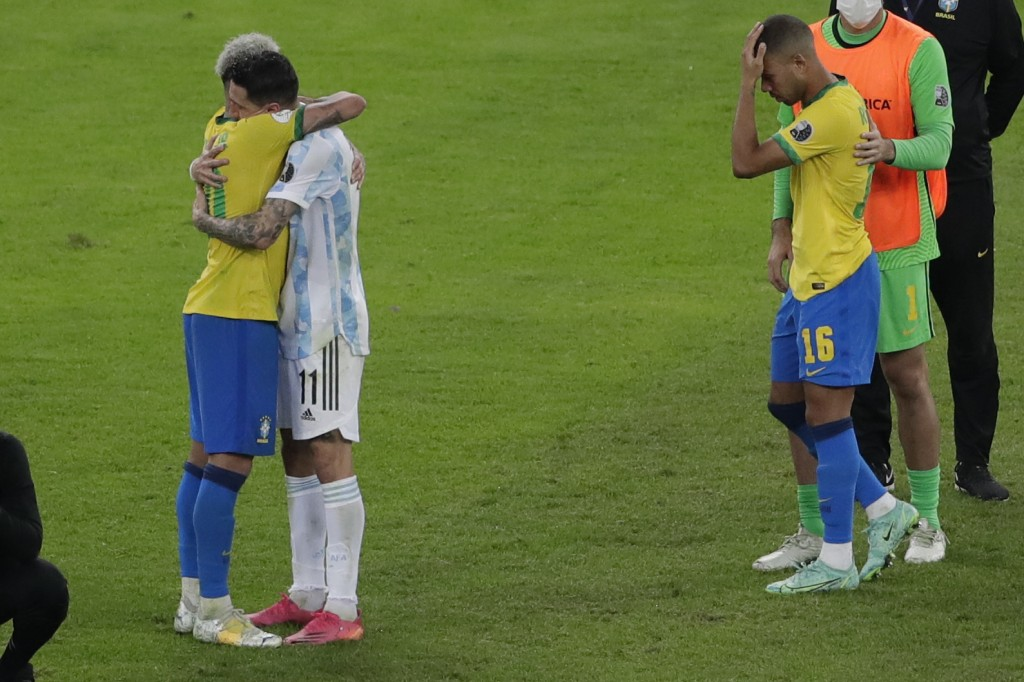 Brazil's Neymar, left, embraces Argentina's Angel Di Maria at the end of the Copa America final soccer match at Maracana stadium in Rio de Janeiro, Br...