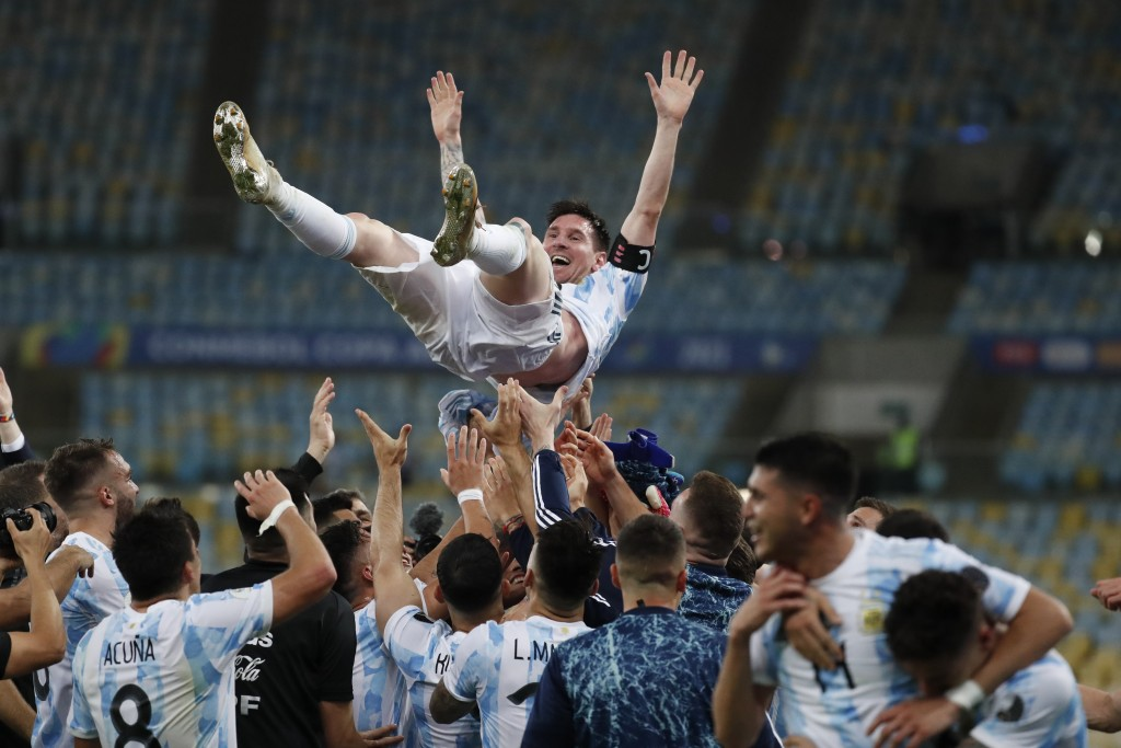 Teammates lift Argentina's Lionel Messi after beating Brazil 1-0 in the Copa America final soccer match at the Maracana stadium in Rio de Janeiro, Bra...