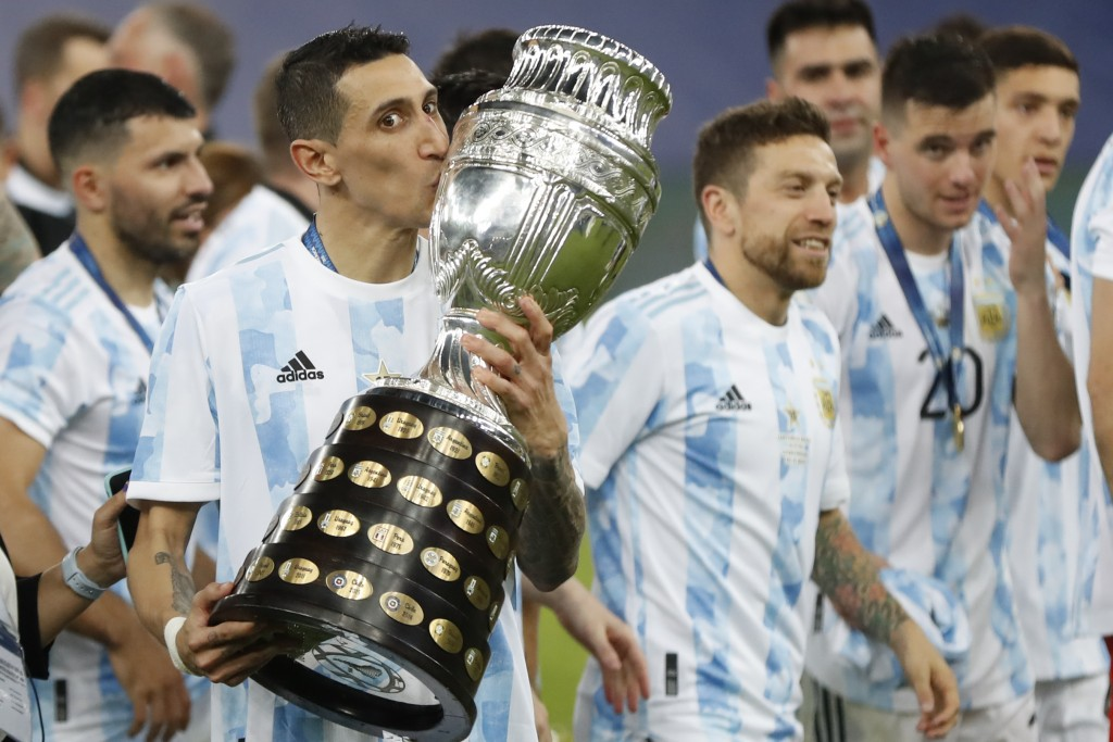 Argentina's Angel Di Maria kisses the trophy as he celebrates with teammates after beating 1-0 Brazil in the Copa America final soccer match at the Ma...