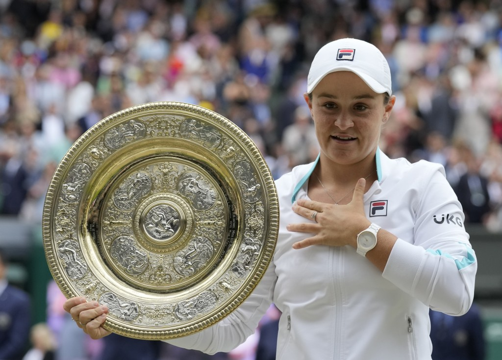 Australia's Ashleigh Barty poses with the trophy for the media after winning the women's singles final, defeating the Czech Republic's Karolina Plisko...