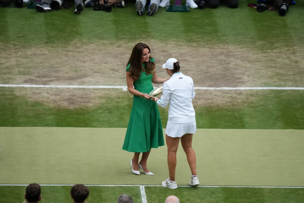 Kate, Duchess of Cambridge, presents the winning trophy to Australia's Ashleigh Barty after she won the women's singles final match against Czech Repu...