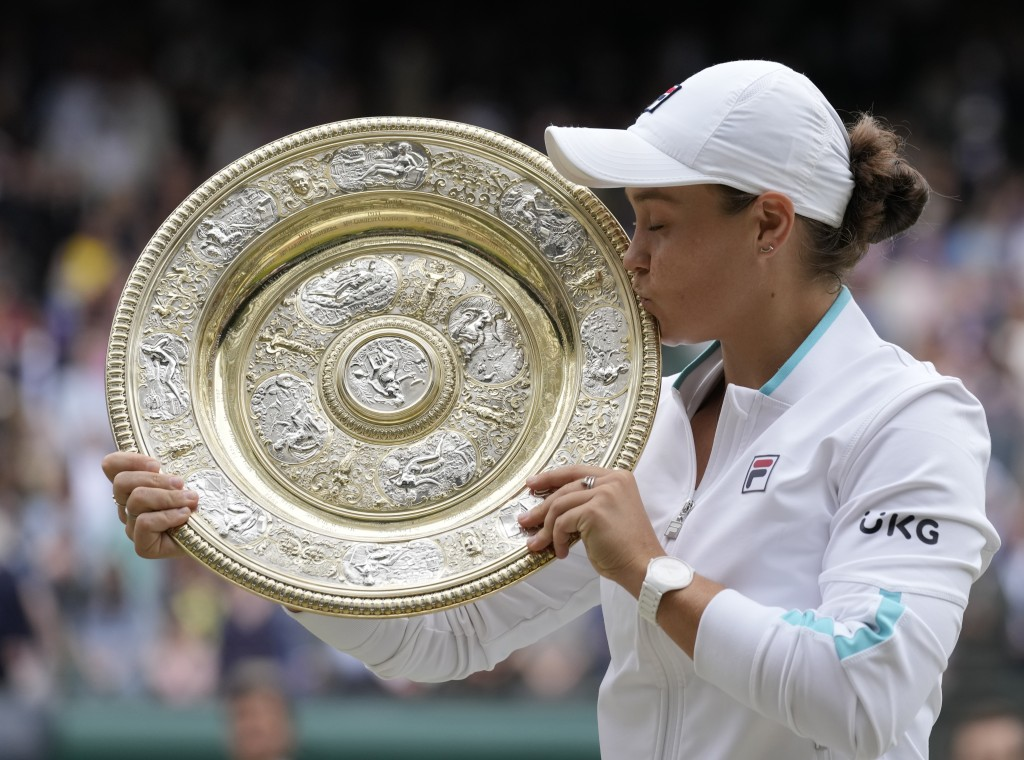Australia's Ashleigh Barty poses with the winners trophy for the media after winning the women's singles final after defeating the Czech Repub...