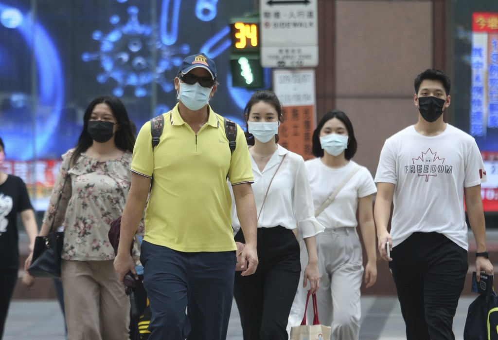 People wear face masks to help protect against the spread of the coronavirus after the COVID-19 alert rose to level 3 in Taipei, Taiwan, Monday, July ...