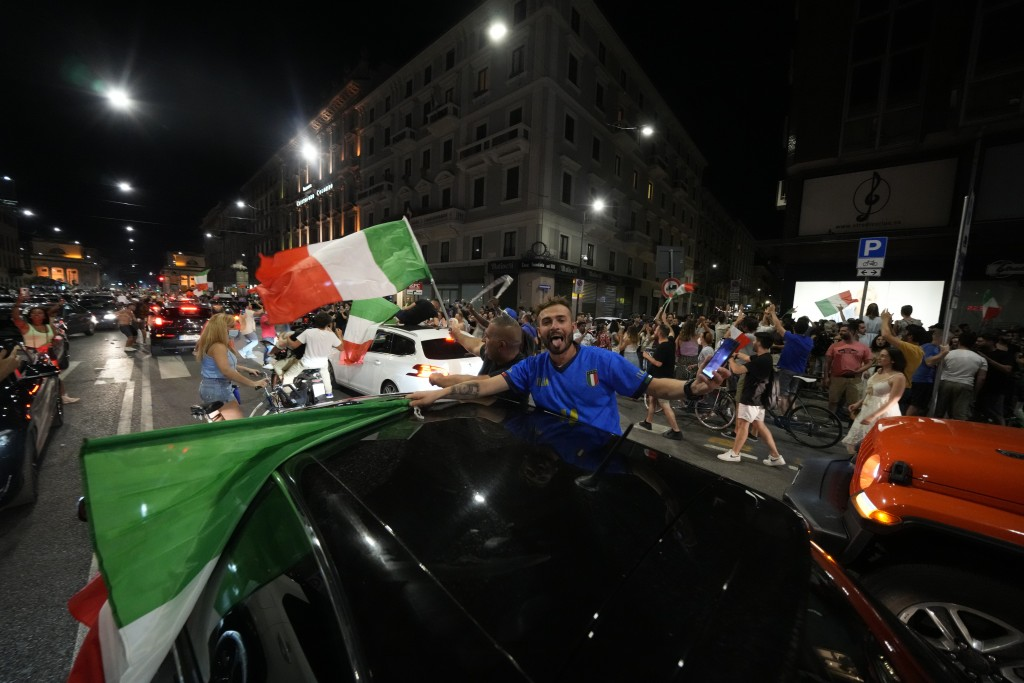 Italy's fans celebrate in Milan, Italy, Monday, July 12, 2021, after Italy beat England to win the Euro 2020 soccer championships in a final played at...
