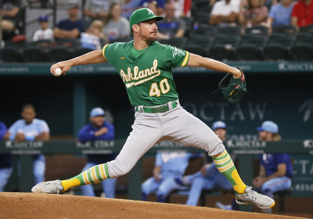 Oakland Athletics starting pitcher Chris Bassitt throws against the Texas Rangers during the first inning of a baseball game in Arlington, Texas, Sund...