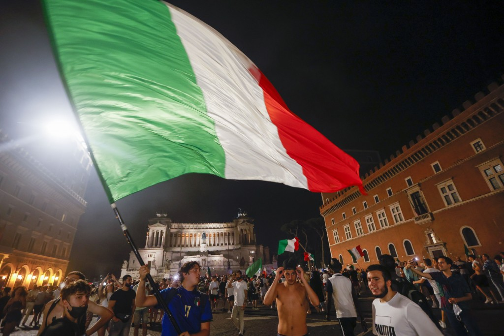 Italy's fans celebrate in Rome, Monday, July 12, 2021, after Italy beat England to win the Euro 2020 soccer championships in a final played at Wembley...