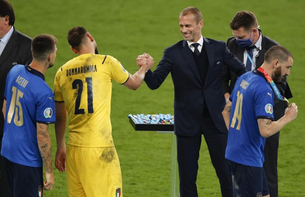 President of UEFA Aleksander Ceferin congratulates Italy's goalkeeper Gianluigi Donnarumma after they defeated England on the Euro 2020 soccer champio...