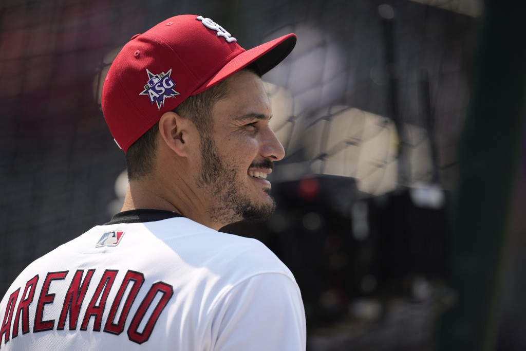 National League's Nolan Arenado, of the St. Louis Cardinals, warms-up during batting practice for the MLB All-Star baseball game, Monday, July 12, 202...