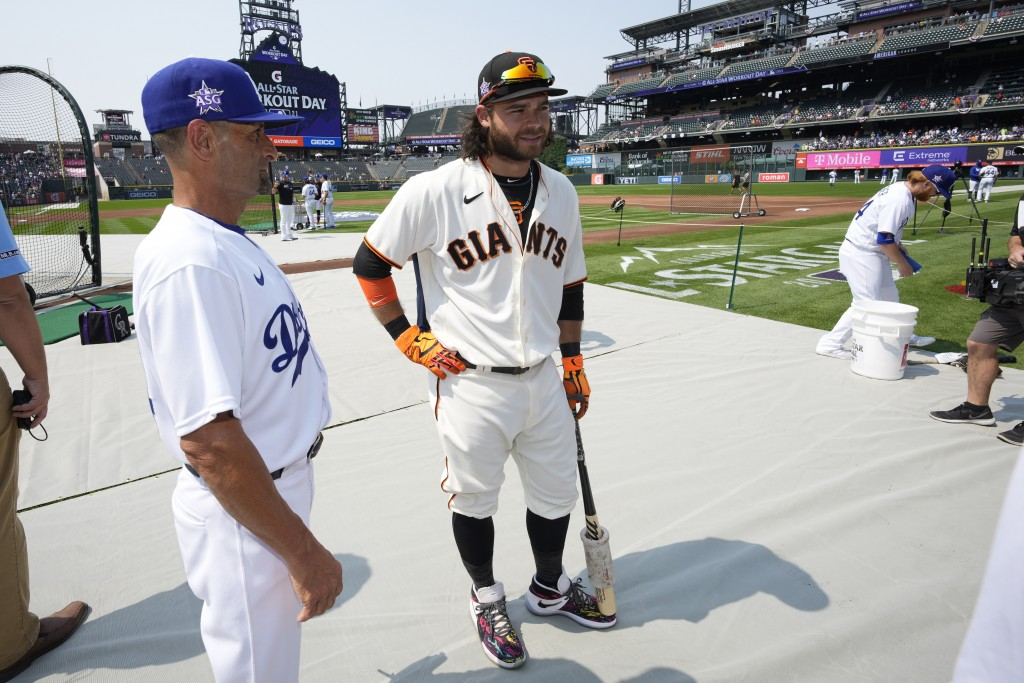 National League's Brandon Crawford, of the San Francisco Giants, waits to hit during batting practice for the MLB All-Star baseball game, Monday, July...