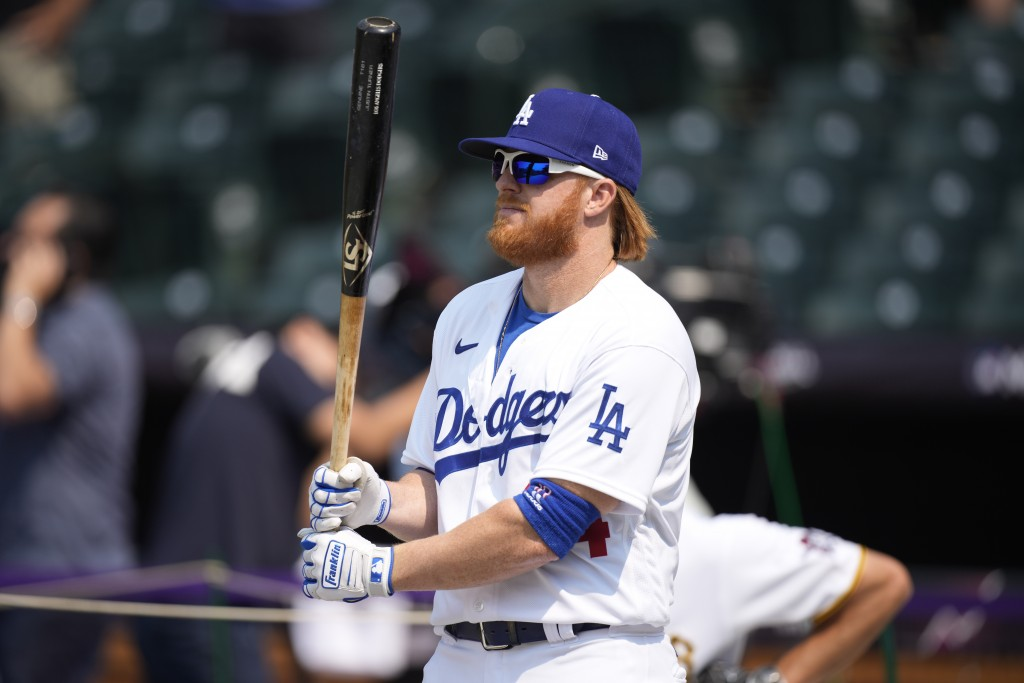 National League's Justin Turner, of the Dodgers warms-up during batting practice for the MLB All-Star baseball game, Monday, July 12, 2021, in Denver....
