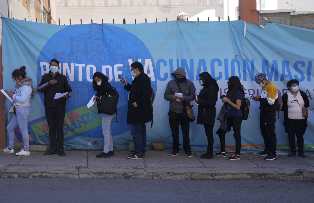 People line up for shot of the Sinopharm COVID-19 vaccine during a vaccination campaign for people over 18 in La Paz, Bolivia, Monday, July 12, 2021. ...