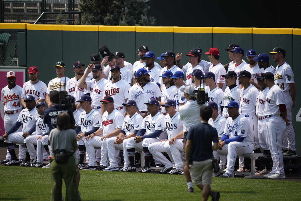 The American League baseball All Stars pose for a team picture in centerfield at Coors Field, Monday, July 12, 2021, in Denver. (AP Photo/David Zalubo...