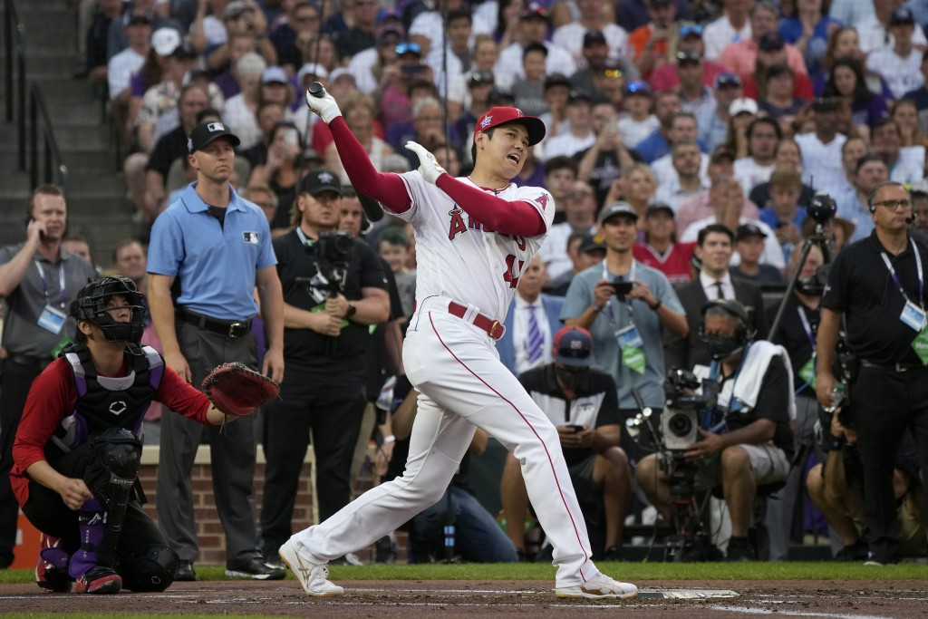 American League's Shohei Ohtani, of the Los Angeles Angeles, hits during the first round of the MLB All Star baseball Home Run Derby, Monday, July 12,...