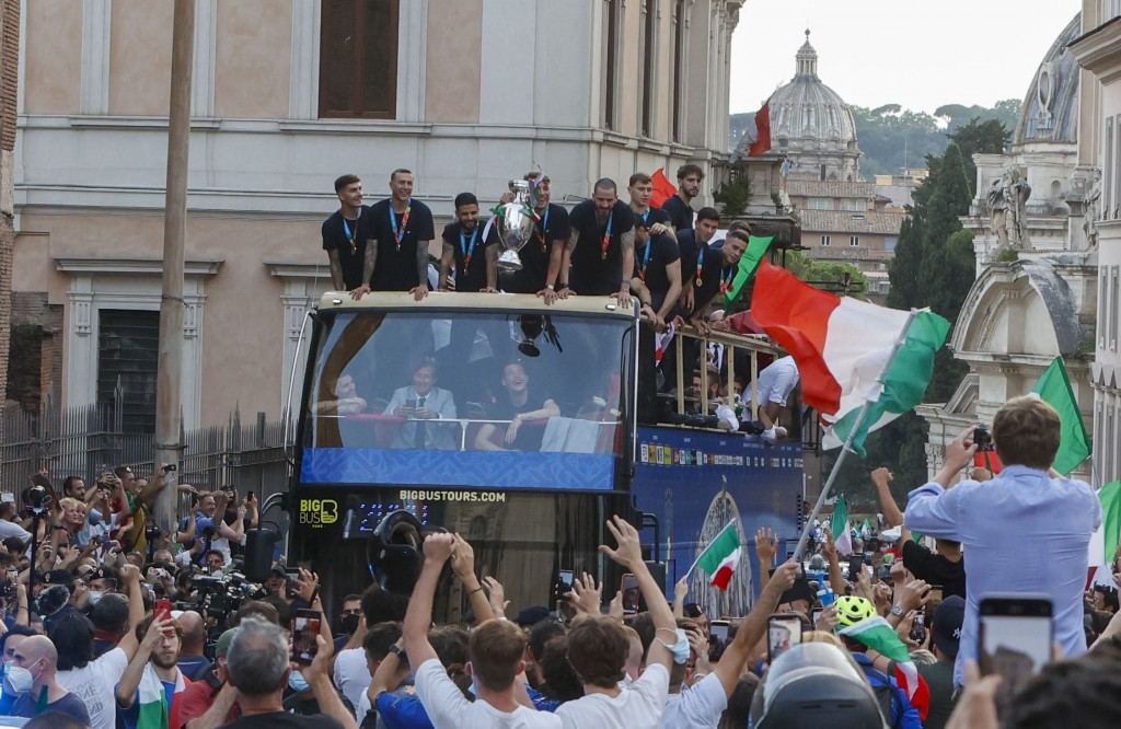 Italy's players celebrate in Rome, Monday, July 12, 2021, after their victory at the Euro 2020 soccer championships in a final played at Wembley stadi...