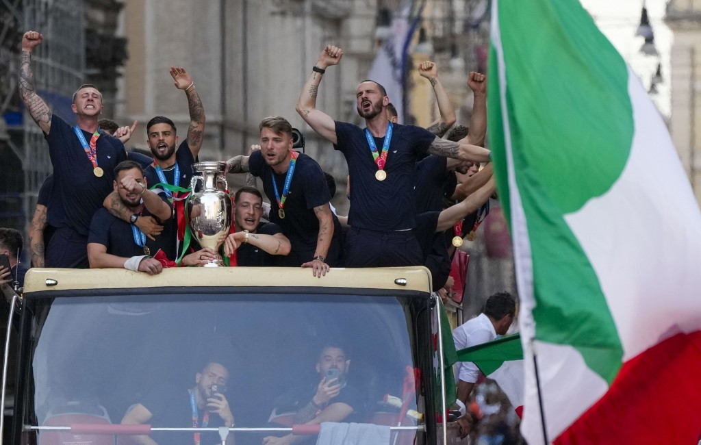 Italy's players celebrate in Rome, Monday, July 12, 2021, their victory of the Euro 2020 soccer championships in a final played at Wembley stadium in ...