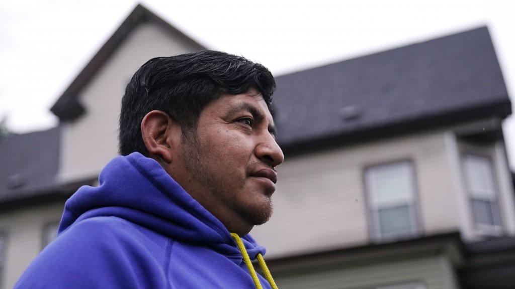 Lucio Perez poses outside his home, where he has lived with his family since March, Thursday, July 8, 2021, in Springfield, Mass. Just a few months ag...