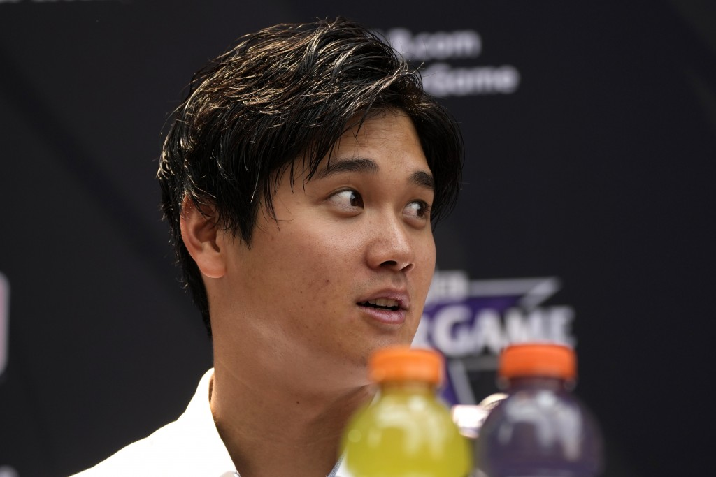 Shohei Ohtani, of the Los Angeles Angeles, speaks after being named the American League's starting pitcher for the MLB All-Star baseball game, Monday,...