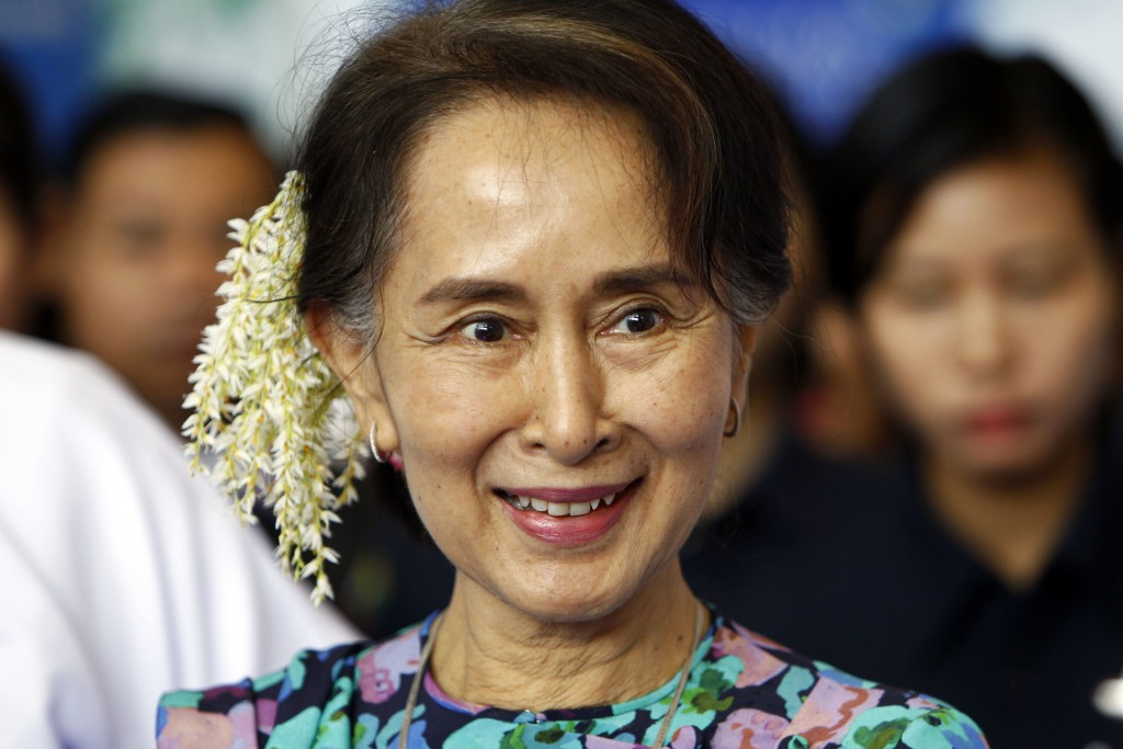 FILE - In this Dec. 14, 2018, file photo, ousted Myanmar leader Aung San Suu Kyi arrives to attend the Myanmar Entrepreneurship Summit at the Myanmar ...