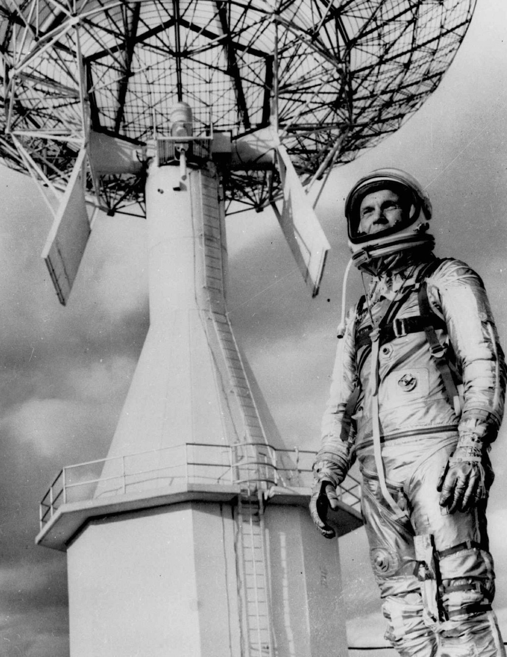 FILE- In this June 18, 1963, file photo, astronaut John Glenn, the first American to orbit the earth, poses before a Project Mercury tracking station ...