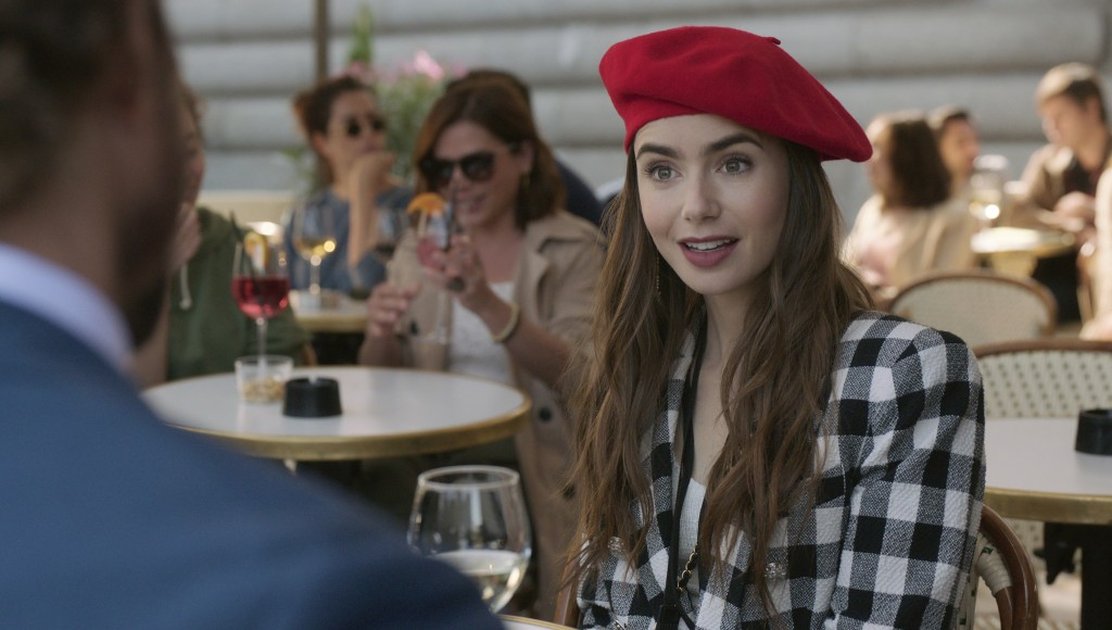 """This image released by Netflix shows Lily Collins in a scene from the series """"Emily in Paris."""" The program was nominated for an Emmy Award for outstan..."""