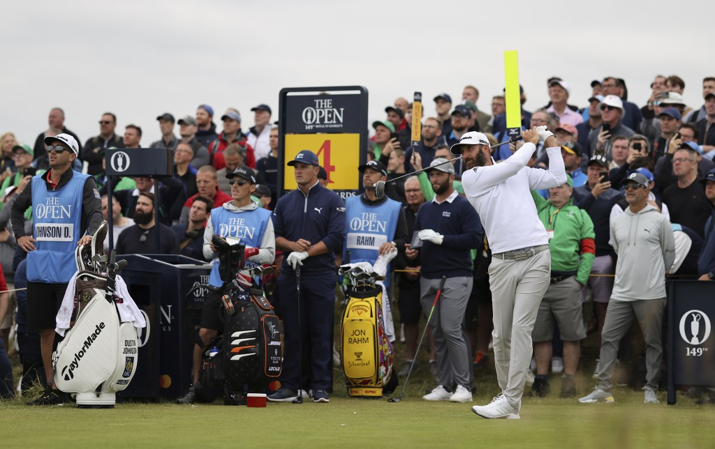 United States' Dustin Johnson plays his tee shot on the 4th during a practice round for the British Open Golf Championship at Royal St George's golf c...