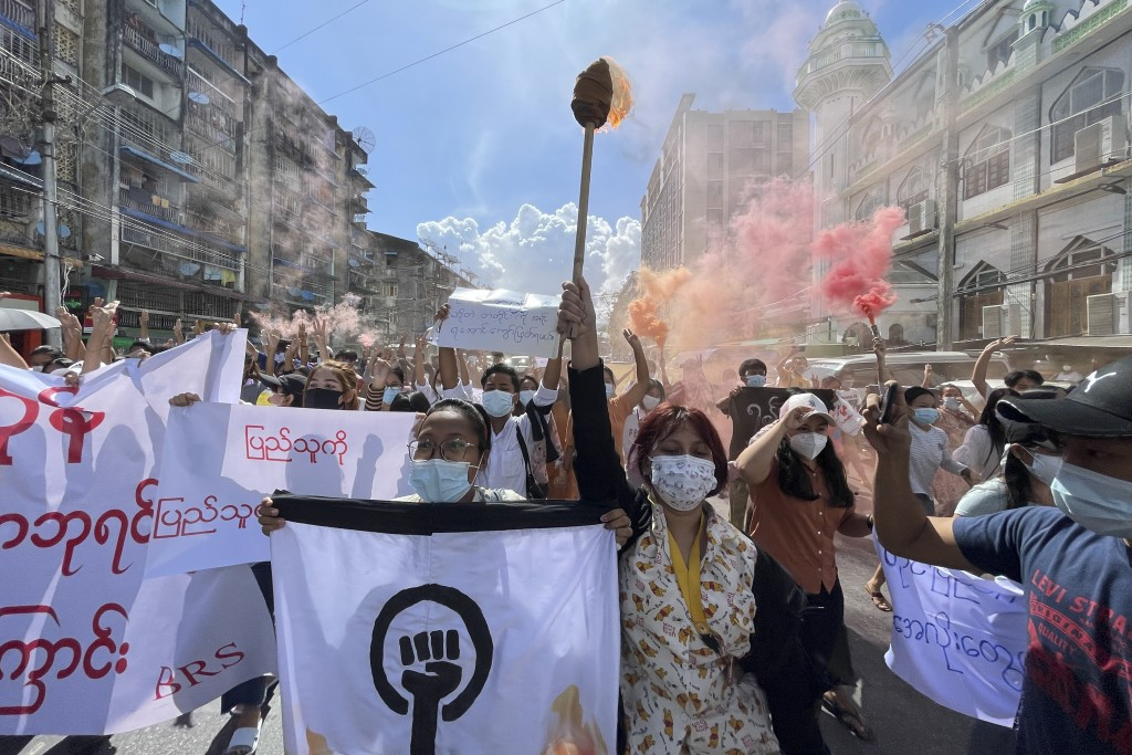 Protesters march holding slogans during a protest at Pazundaung township in Yangon, Myanmar, Wednesday July 14, 2021. (AP Photo)