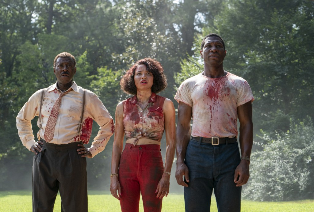 """This image released by HBO shows, from left, Courtney B. Vance, Jurnee Smollett and Jonathan Majors in a scene from """"Lovecraft Country.""""  The program ..."""